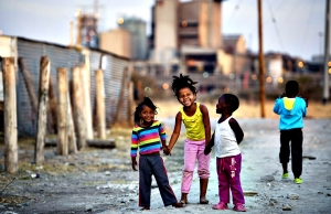 Children play on July 9, 2013 in the Nka...Children play on July 9, 2013 in the Nkaneng shantytown next to the platinum mine, run by British company Lonmin, in Marikana. On August 16, 2012, police at the Marikana mine open fire on striking workers, killing 34 and injuring 78, during a strike was for better wages and living conditions. Miners still live in dire conditions despite a small wage increase.  AFP PHOTO / ODD ANDERSENODD ANDERSEN/AFP/Getty Images