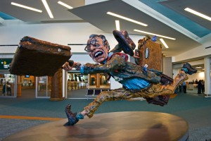 A statue of a traveler at the Vancouver Airport running to catch a plane