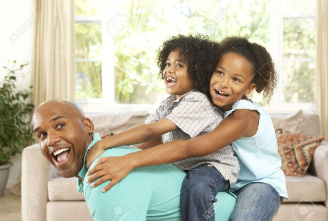 6135765-Father-Playing-With-Children-At-Home-Stock-Photo