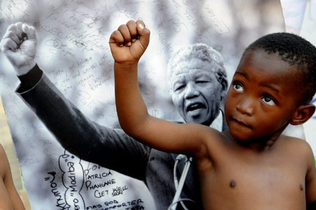 child_imitating_mandela.jpg.size.custom.crop.1086x724