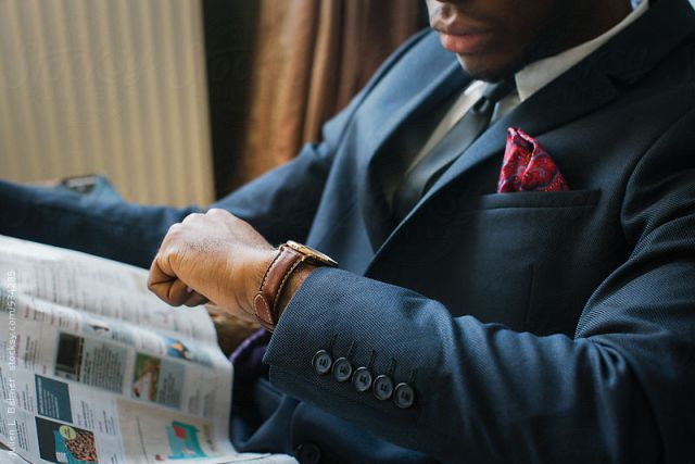 Close Up of Elegantly Dressed Young Black Man Checking Time on W
